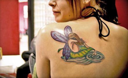 Golden Tattoo Artist And Studio